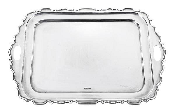 A silver shaped rectangular tray by Walker & Hall,
