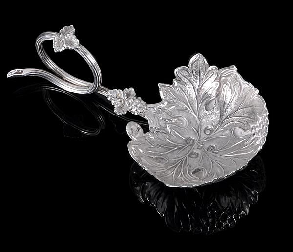 A Victorian silver naturalistic caddy spoon by