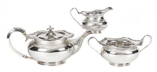 An Edwardian silver compressed circular three