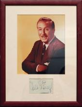 Disney, Walt - Ink signature on album page, mounted together with a black and...