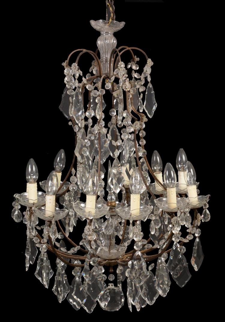 A Continental cut glass twleve light chandelier in Louis XV taste