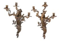 A pair of gilt bronze three light wall appliques in Louis XIV style