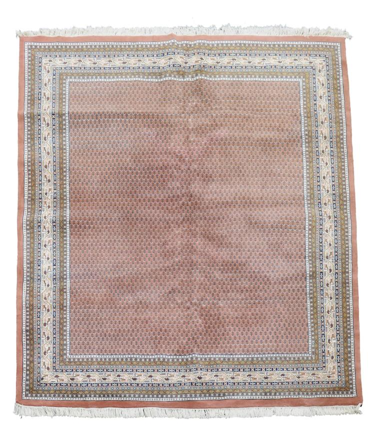 An Indian carpet, approximately 230cm 305cm