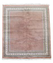 An Indian carpet, approximately 230cm 305cm