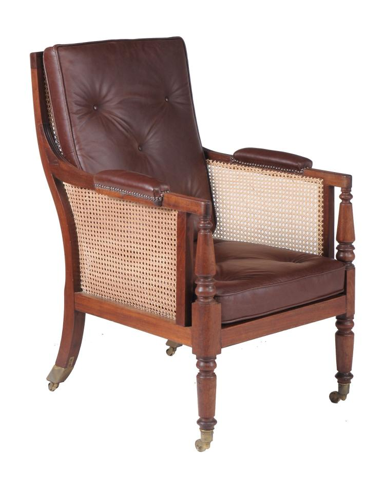 A mahogany bergere library chair in Regency style, late 19th/early 20th century