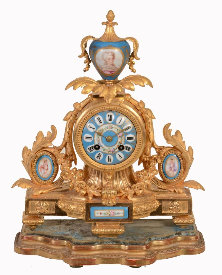 A French Sevres style porcelain inset gilt metal mantel clock