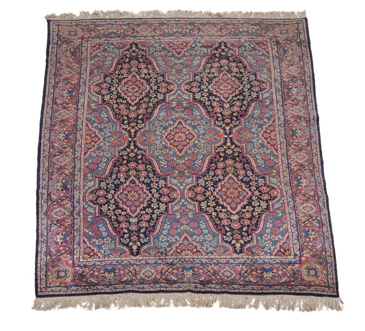 A Kirman carpet , approximately 321cm x 213cm