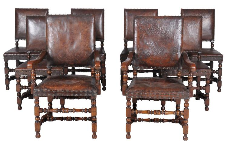 A set of eight oak and leather upholstered dining chairs in 17th century Cromwellian style, 19th century, to include two armchairs