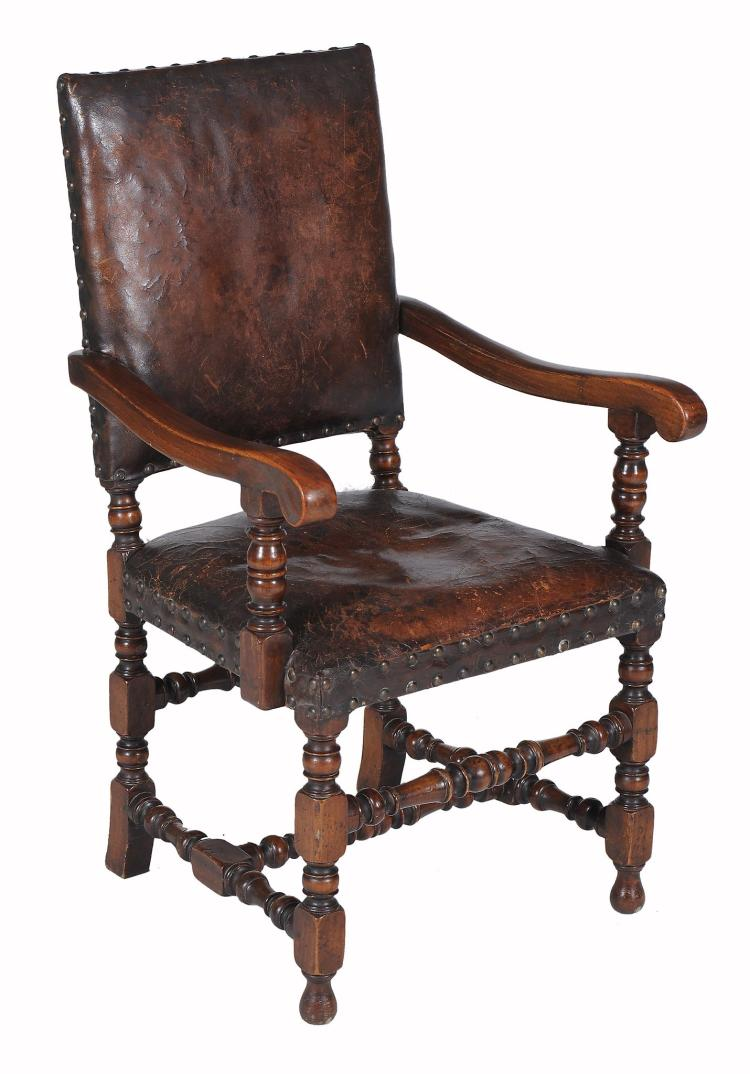A set of eight oak and leather upholstered dining chairs in for Leather upholstered dining chairs