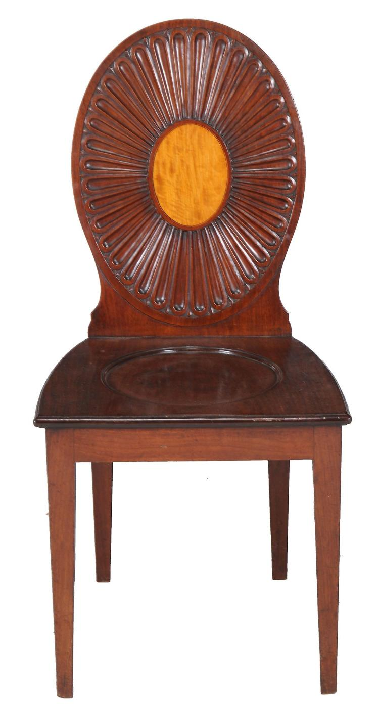 A George III mahogany hall chair, circa 1780, after a design by Ince and Mayhew