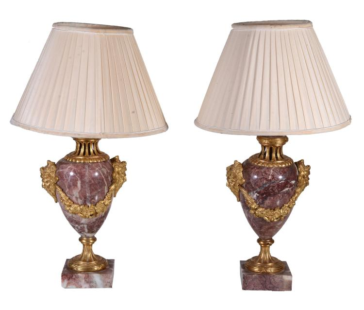 A pair of variegated marble and gilt bronze mounted urns fitted as table lamps