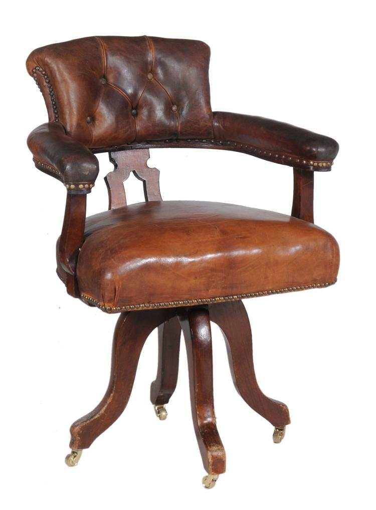 A leather upholstered revolving desk armchair, circa 1880, 98cm high, 57cm wide