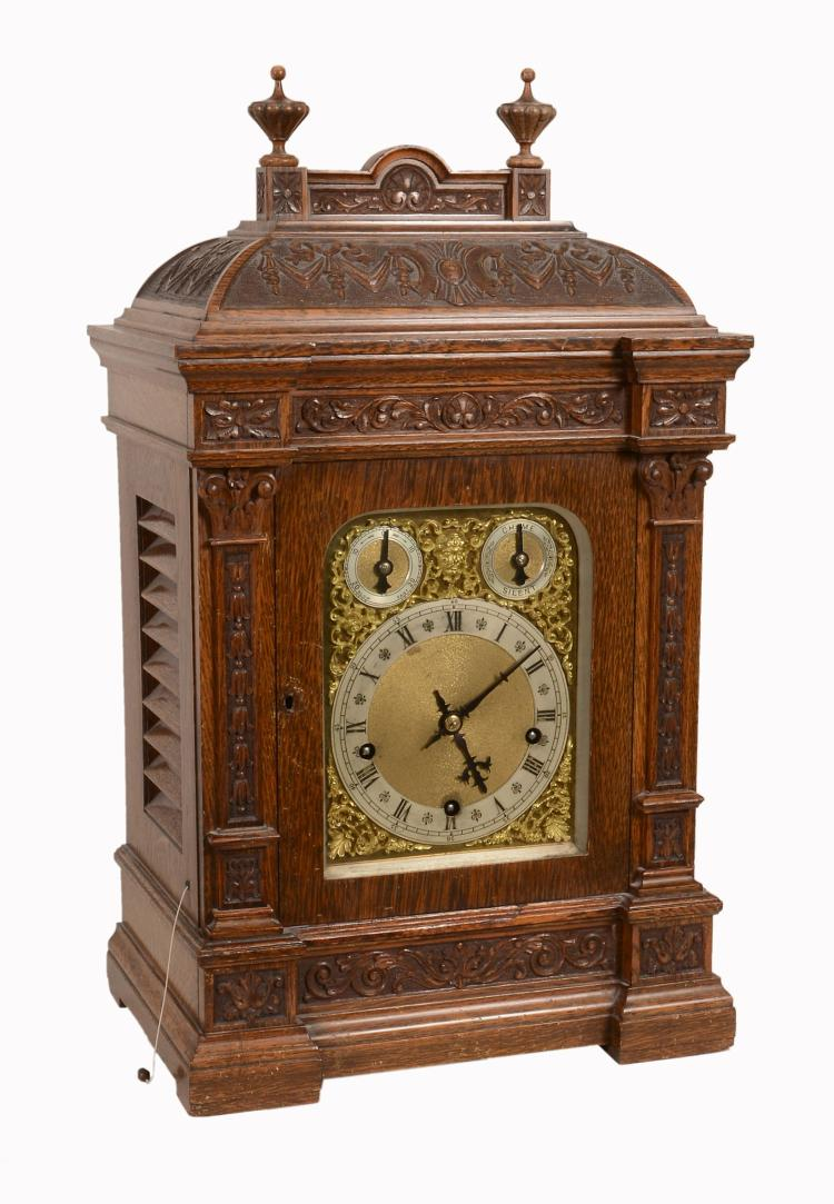 A German carved oak mantel clock, late 19th/early 20th century
