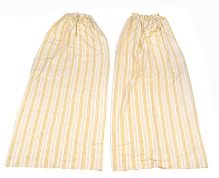 A quantity of yellow and cream patterned curtains, of two varying designs