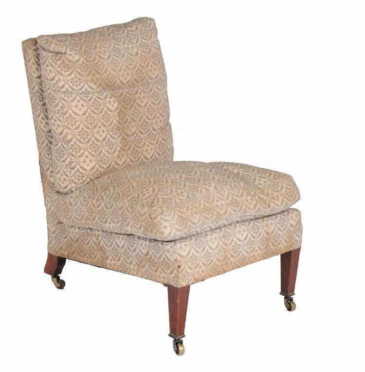 A Howard & Sons low chair , late 19th/early 20th century