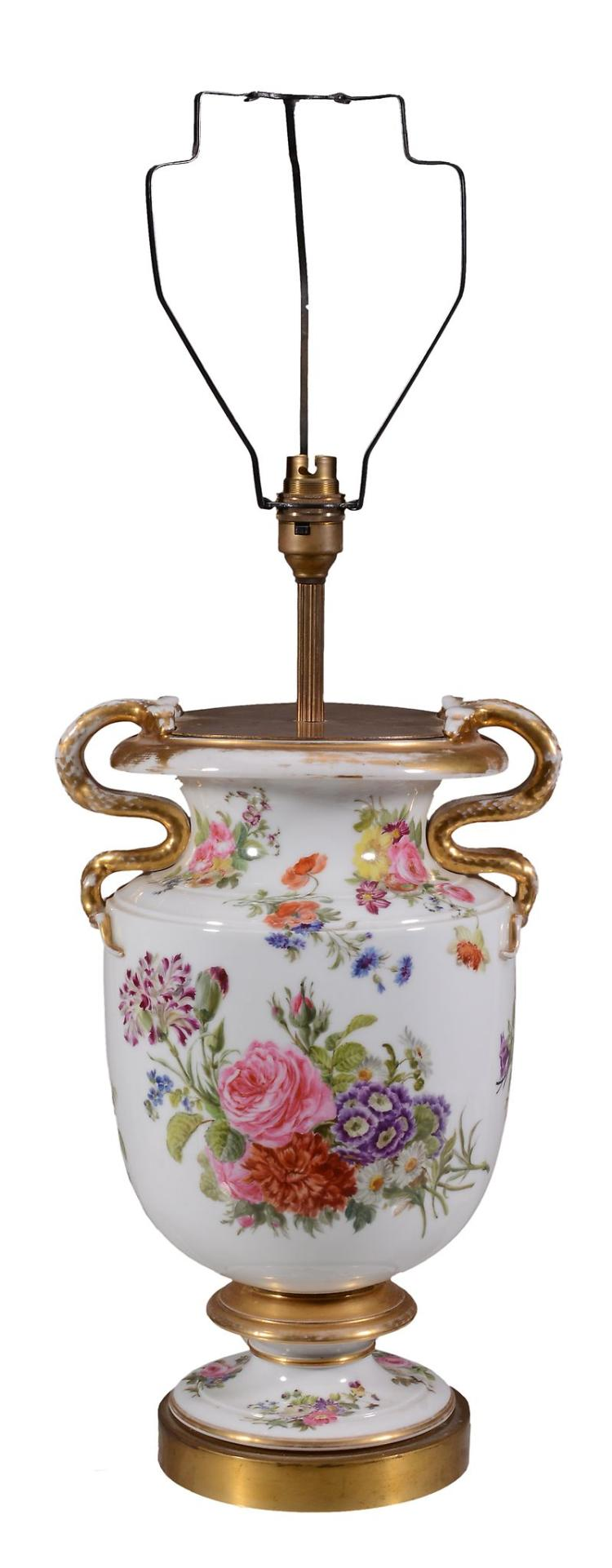 A French porcelain two-handled urn fitted for electricity as a lamp