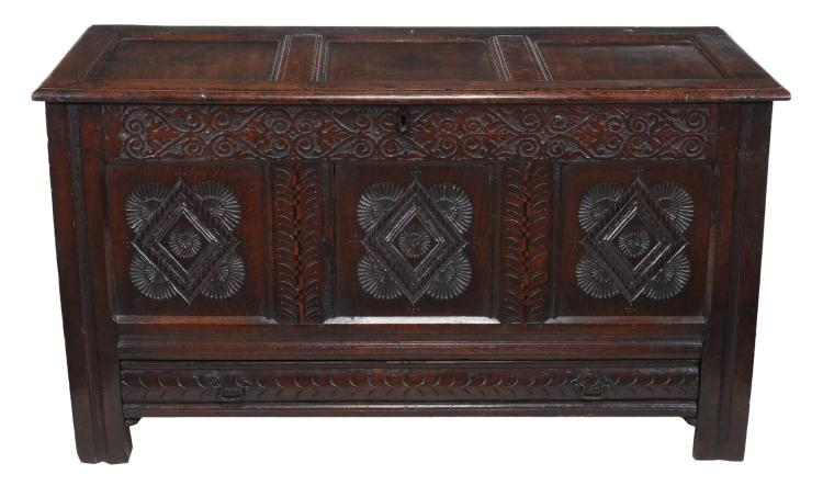 A carved and inlaid oak coffer , 17th century and later