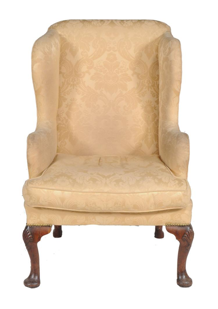 A mahogany upholstered wing armchair , mid 18th century and later , 108cm high