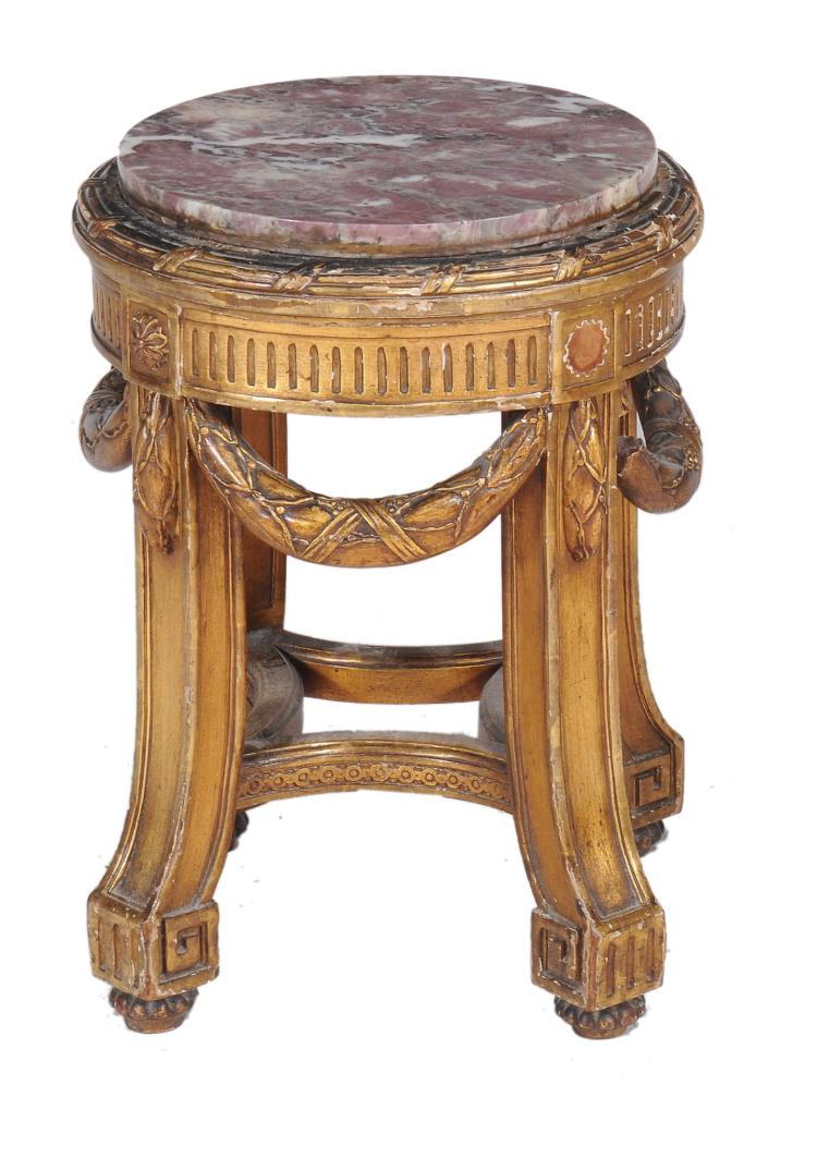 A Continental carved giltwood marble topped torchere stand , late 19th century
