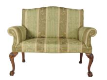 A pair of walnut and upholstered sofas in Queen Anne style