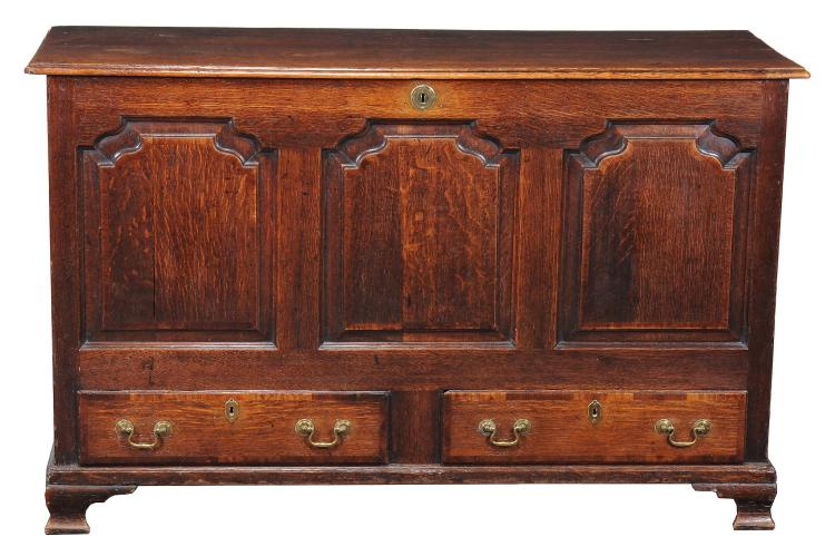 A George II oak mule chest, circa 1760, the hinged top above a pair of drawers