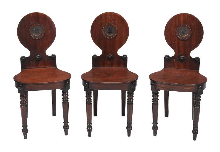 A set of three Regency mahogany hall chairs , circa 1815