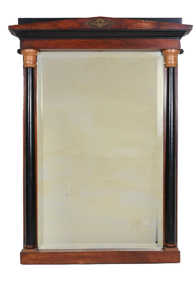 A Continental mahogany and gilt metal mounted mirror in Empire taste