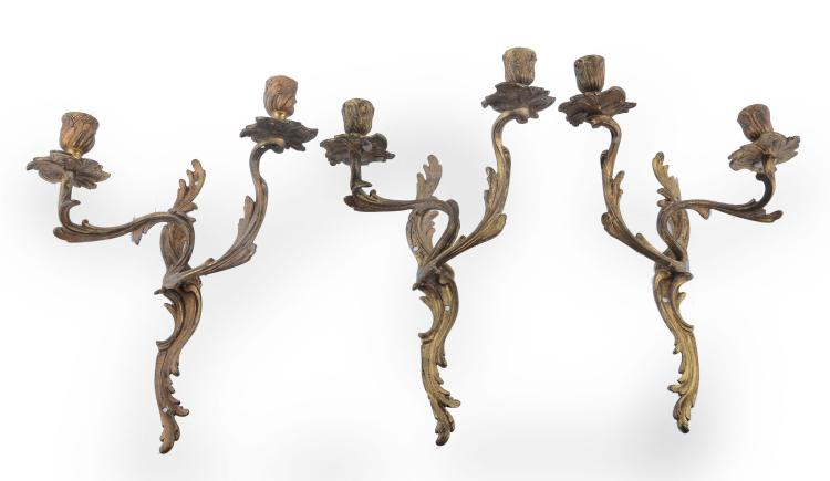 A pair of gilt bronze twin light wall appliques in Louis XV taste