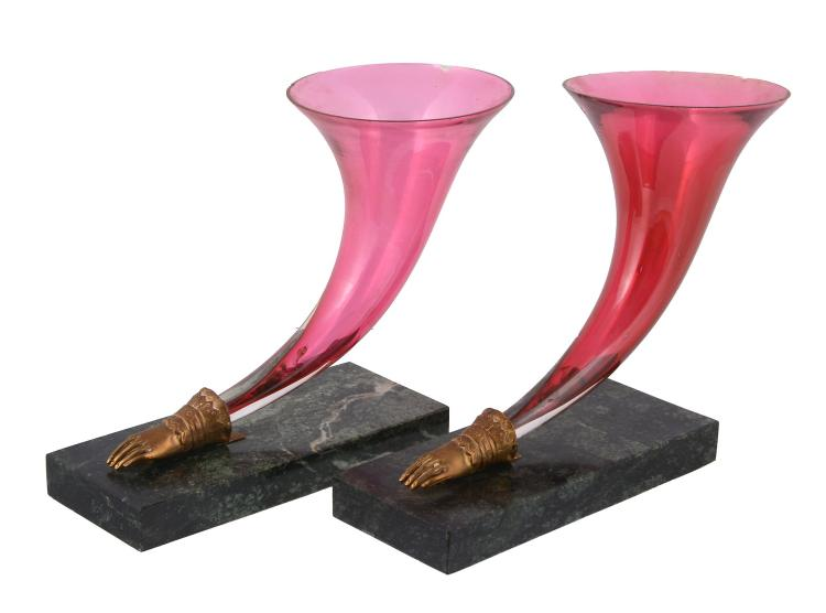 A pair of Victorian cranberry glass and marble mounted cornucopia vases