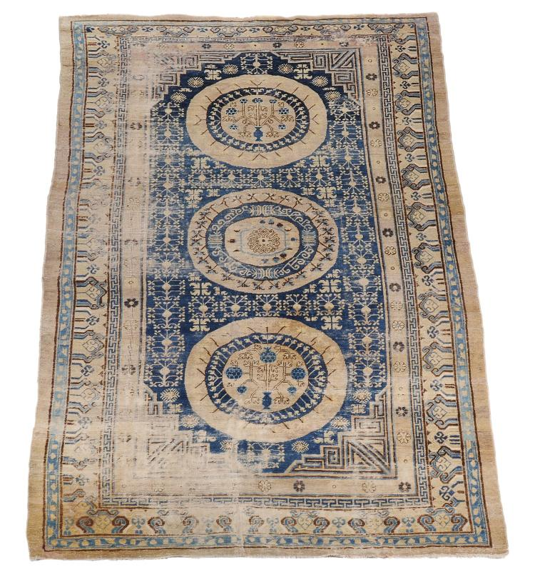 A Chinese carpet , approximately 293cm x 210cm