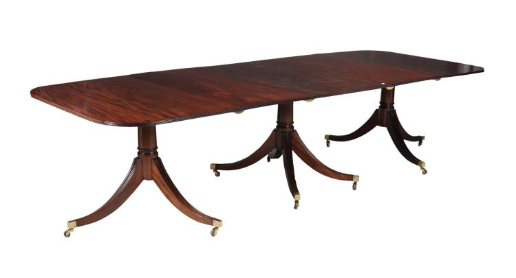 A mahogany triple pillar dining table in George III style , late 19th century