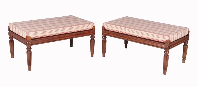 A pair of padouk centre stools , 20th century