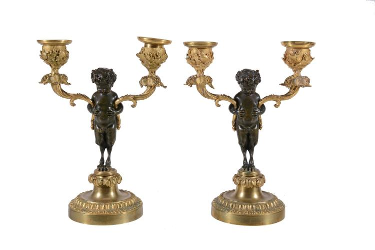 A pair of Continental, probably Italian patinated and gilt bronze twin light...