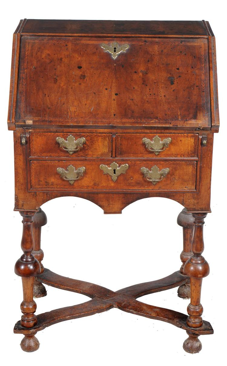 A walnut and feather-banded bureau, early 18th century and later