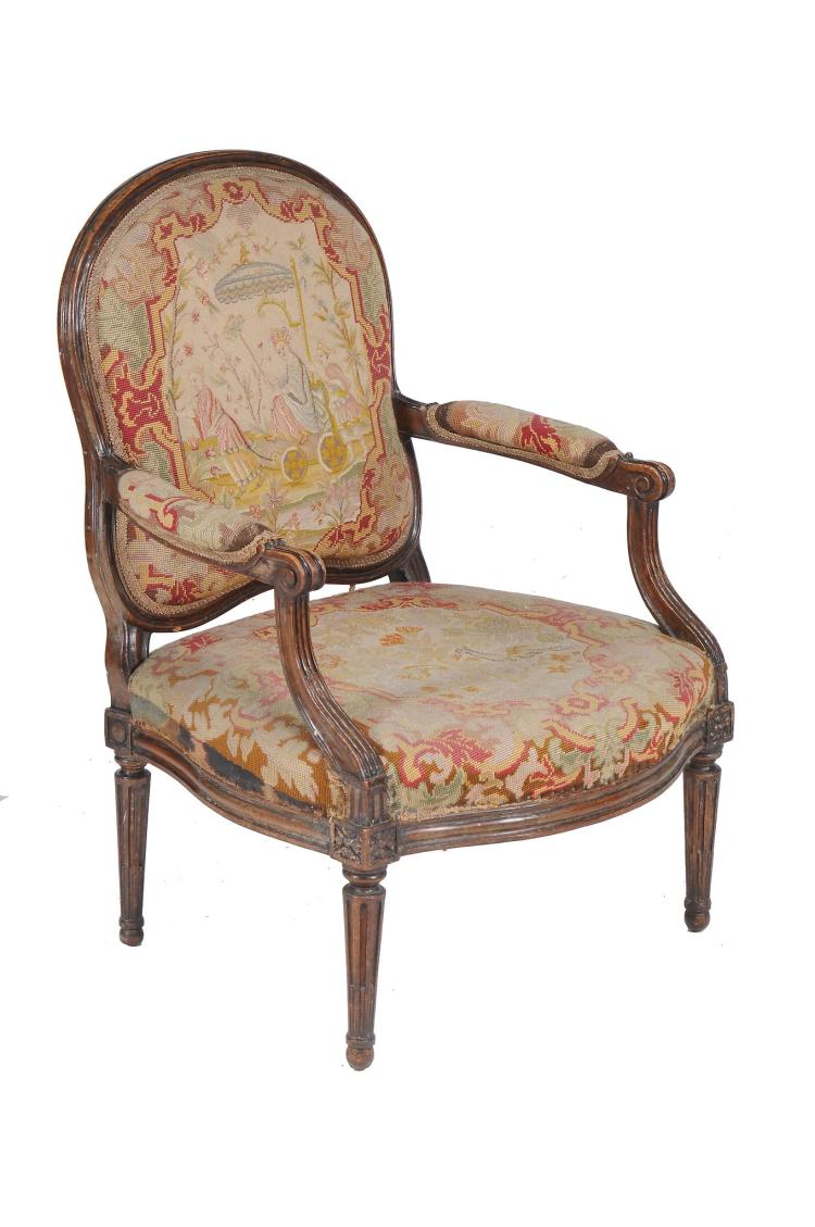 A walnut fauteuil in Louis XVI style , 19th century, 100cm high, 71cm wide