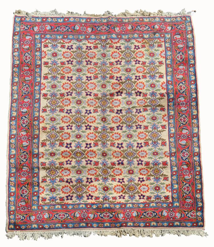 An Indian carpet, approximately 335 x 227cm