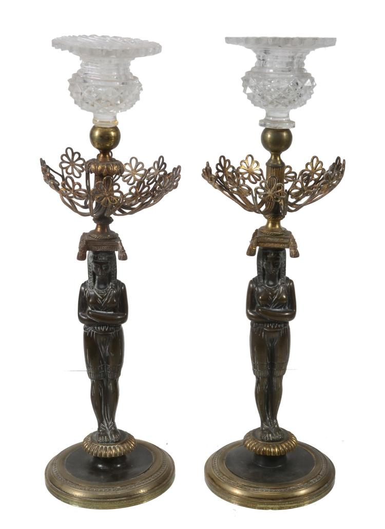A pair of Continental patinated and gilt bronze and cut glass mounted...