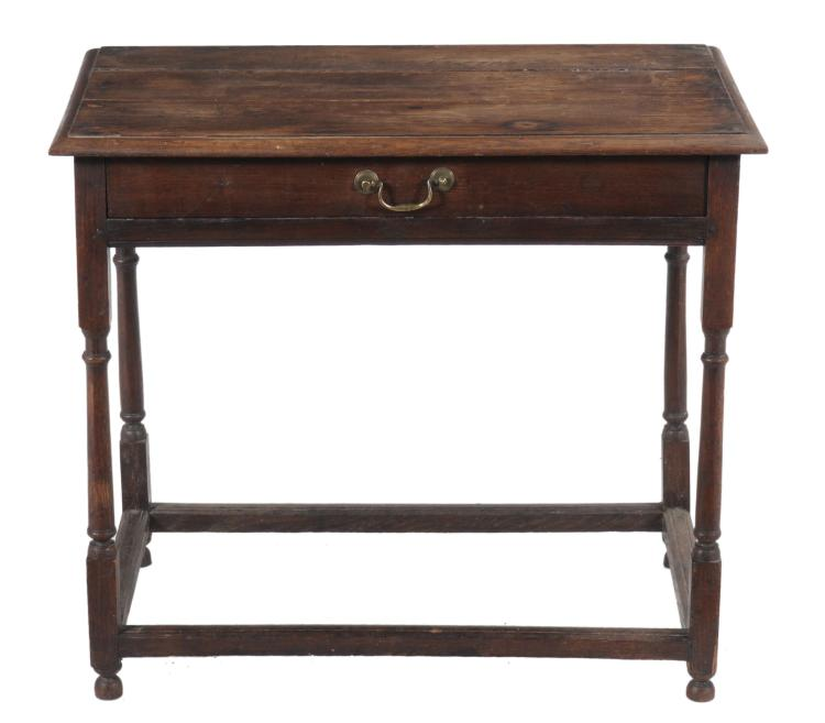 A Queen Anne oak side table , circa 1710, 69cm high, 79cm wide, 49cm deep