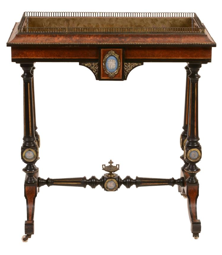 A mid Victorian amboyna and ebonised jardiniere , circa 1860