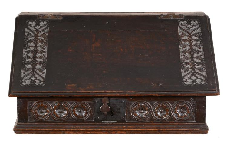 A carved oak bible box, circa 1680 and later, 33cm high, 63cm wide, 42cm deep
