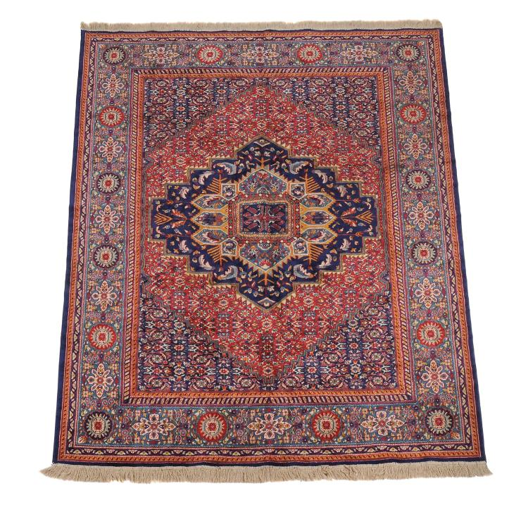 A Kashan carpet , approximately 288cm x 197cm