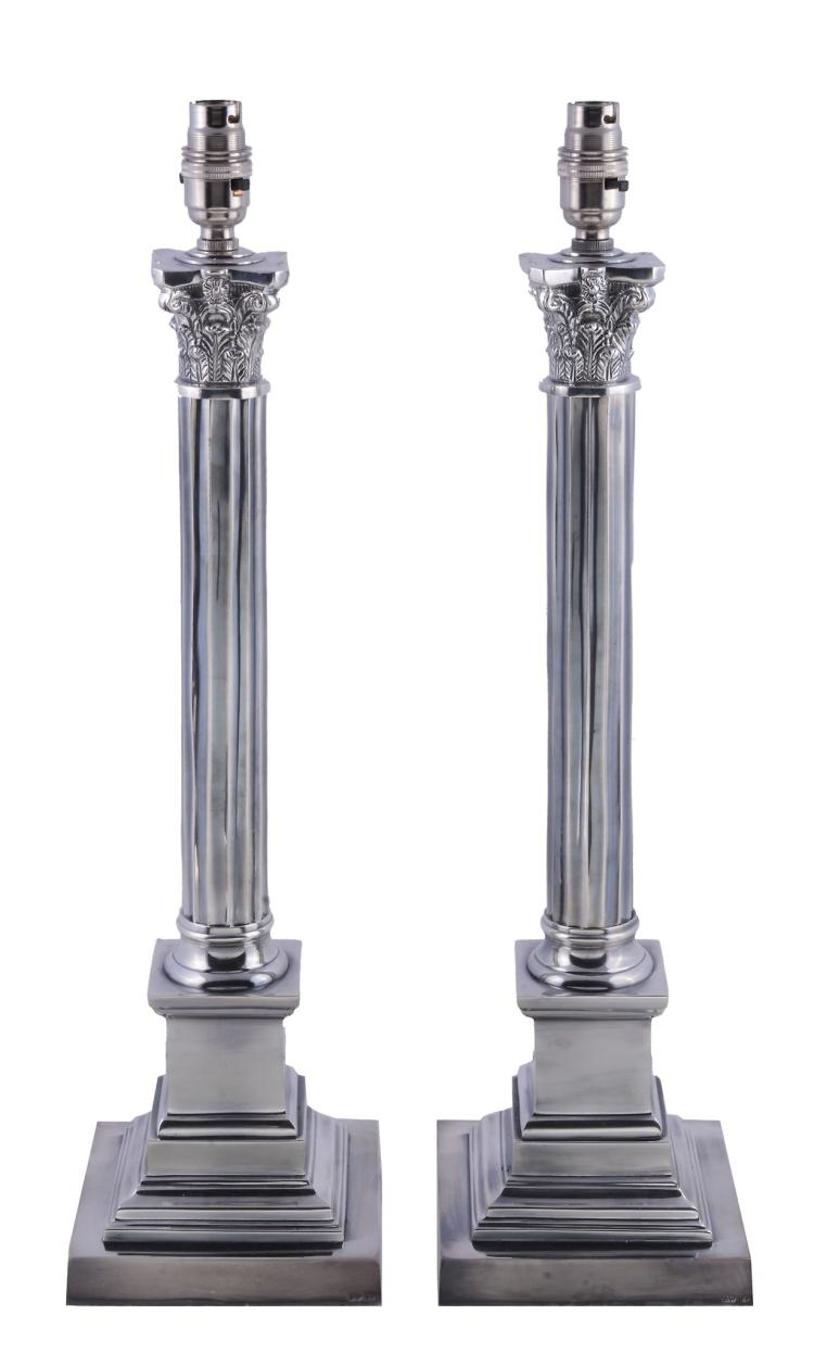 A pair of silver plated metal columnar table lamps, of recent manufacture