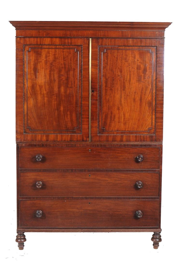 A George III mahogany clothes press , circa 1800