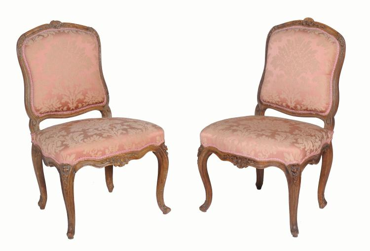 A pair of French Louis XV stained beech side chairs, 18th century