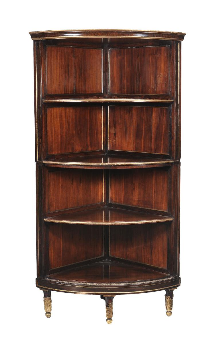 A Regency rosewood and parcel gilt open corner bookcase, circa 1815, 190cm high