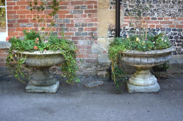 A pair of substantial stone composition garden urns, 20th century