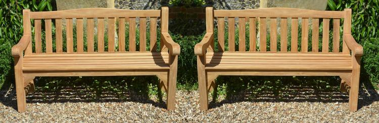 A pair of stained teak garden benches, modern, each with slatted back and seat