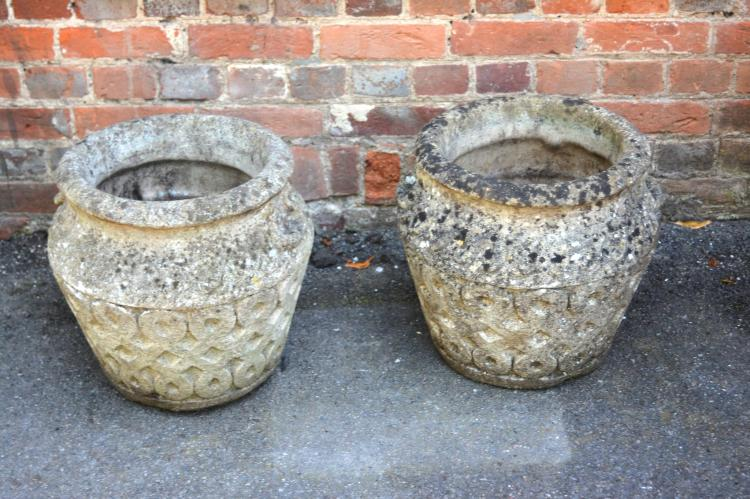 A pair of Cotswold Studio stone composition garden urns, 20th century