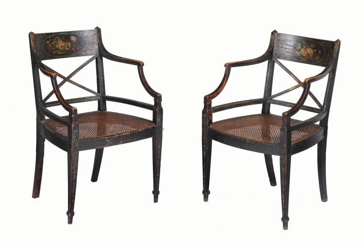 A pair of late George III ebonised and polychrome painted beech elbow chairs
