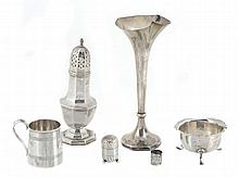 A collection of silver items, to include: an octagonal baluster caster by...